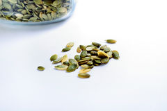 Pumpkin seeds on white Royalty Free Stock Photos
