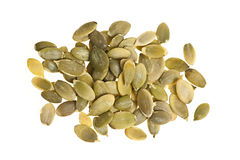 Pumpkin seeds on white Royalty Free Stock Photography