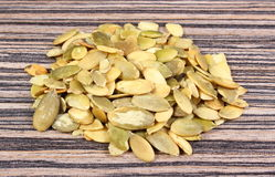 Pumpkin seeds on wooden background Royalty Free Stock Photos