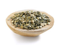 Pumpkin seeds in a wooden bowl Royalty Free Stock Photos