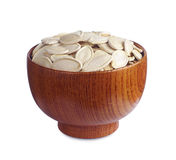 Pumpkin seeds in wooden bowl Royalty Free Stock Photo