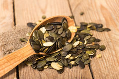 Pumpkin seeds. On a wooden table Stock Images