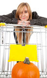 Pumpkin, shopping cart and girl Stock Images