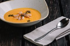 Pumpkin shrimp cream soup served with spoon Royalty Free Stock Images