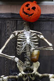 Pumpkin and skeleton Royalty Free Stock Photo