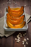 Pumpkin slice baked Stock Images