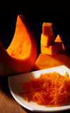 Pumpkin slice and grated Royalty Free Stock Images