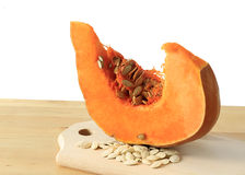 Pumpkin slice and pumpkin seeds Royalty Free Stock Photography