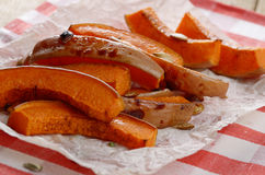 Pumpkin slices on baking paper Royalty Free Stock Image