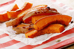 Pumpkin slices on baking paper Royalty Free Stock Photography