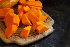 Pumpkin slices on a dark  background. Pumpkin slices on a dark background close up Stock Photography