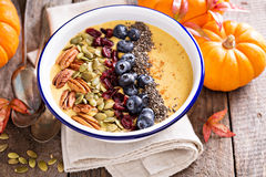 Pumpkin smoothie bowl with chia seeds, pecans, cranberries Royalty Free Stock Photography
