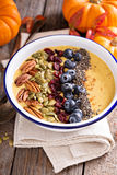 Pumpkin smoothie bowl with chia seeds, pecans, cranberries Stock Image