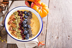 Pumpkin smoothie bowl with chia seeds, pecans, cranberries Royalty Free Stock Photos