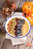 Pumpkin smoothie bowl with chia seeds, pecans, cranberries Stock Images