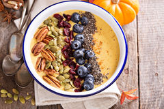 Pumpkin smoothie bowl with chia seeds, pecans, cranberries Royalty Free Stock Image