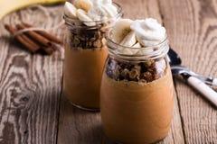 Pumpkin smoothie with granola and bananas Stock Photos