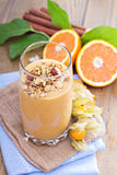 Pumpkin smoothie with granola on top Stock Photography