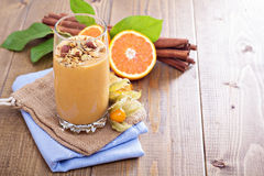 Pumpkin smoothie with granola on top Stock Images