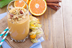 Pumpkin smoothie with granola on top Royalty Free Stock Photos