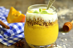 Pumpkin smoothie with granola and yogurt. Stock Image