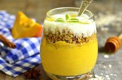 Pumpkin smoothie with granola and yogurt. stock image
