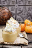 Pumpkin Smoothies. Three fresh Pumpkin Smoothies against a rustic background royalty free stock photo