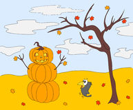 Pumpkin Snowman with a kind face standing under an autumn tree o Royalty Free Stock Image