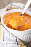 Pumpkin souffle. Just baked pumpkin souffle in white bowl closeup Royalty Free Stock Photography