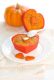 Pumpkin souffle. Pumpkin and apples souffle, decorated with fresh pumpkin and white kitchen towel, dish and spoon Stock Images