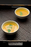 Pumpkin soup. Bowl of pumpkin or squash soup with herbes Royalty Free Stock Photo