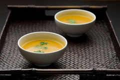 Pumpkin soup. Bowl of pumpkin or squash soup with herbes Stock Image