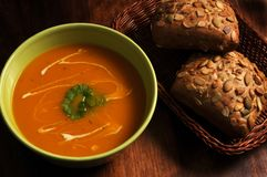 Pumpkin soup. A cup of pumpkin soup with crusty bread Royalty Free Stock Image