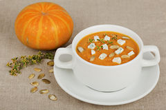 Pumpkin soup. On the table royalty free stock photo
