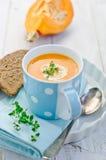 Pumpkin soup. Fresh pumpkin cream soup with  spoon Stock Photos