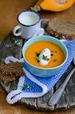 Pumpkin soup. Fresh pumpkin cream soup with  spoon Stock Images