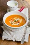 Pumpkin soup. Fresh pumpkin cream soup with  spoon Royalty Free Stock Image