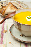 Pumpkin soup. Vegetable soup and bread for lunch or dinner Royalty Free Stock Photos