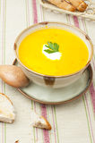 Pumpkin soup. Vegetable soup and bread for lunch or dinner Royalty Free Stock Images