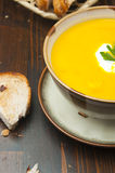 Pumpkin soup. Vegetable soup and bread for lunch or dinner Stock Photography