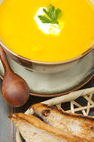 Pumpkin soup. Vegetable soup and bread for lunch or dinner Royalty Free Stock Photo