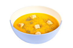 Pumpkin soup. In a bowl over a white background Stock Images