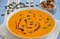 Pumpkin Soup. In a bowl with pumpkin seeds Stock Photos