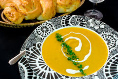 Pumpkin Soup. Served in decorative black and white soup bowl Stock Photos