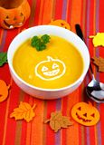 Pumpkin soup with autumn decoration Royalty Free Stock Photos