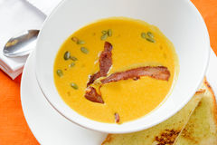 Pumpkin Soup with Bacon. Garnished with rusty bread Stock Photo
