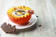 Pumpkin Soup with Bat Toast Crouton Royalty Free Stock Photo