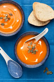 Pumpkin soup on a blue background Royalty Free Stock Image
