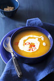 Pumpkin soup in blue bowl Stock Photos