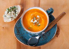 Pumpkin soup with blue cheese  in a blue cup Stock Images